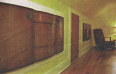 vintage sideboards set into attic wall as extra storage
