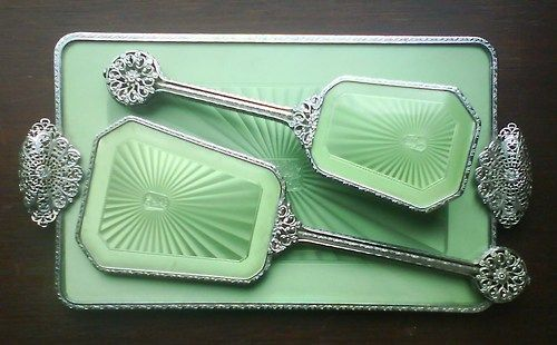 dated:    1930s vanity set.    This vanity set is exquisite. (Additionally, I wholeheartedly recommend dated's tumblr for anyone interested in history/vintage photographs. She posts some real gems.)