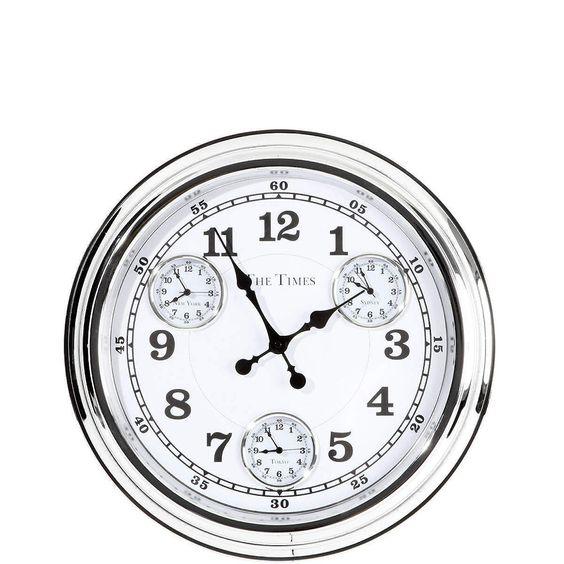 THE TIMES Weltzeituhr    Gleich vier Zeitzonen haben Sie mit der The Times-Weltuhr im Blick. So denken Sie zur richtigen Zeit an Freunde und Verwandte und nehmen in Gedanken am Tagesablauf in der Ferne teil. Aus Metall, batteriebetrieben. In einer weiteren Farbe erhältlich.    Größe: Ø 50 cm, Breite 7 cm  Material: Metall...