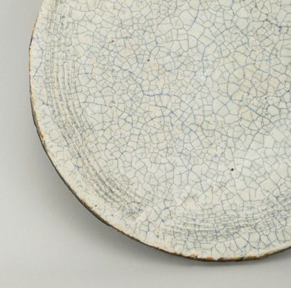 Kogi Yoshikawa. This hand-formed plate is a fine example of Japanese Shigaraki. Kogi created this piece with a local Shiga clay body, with a blue-grey crackle glaze on the interior, and a copper on the underside and edges of the plate.