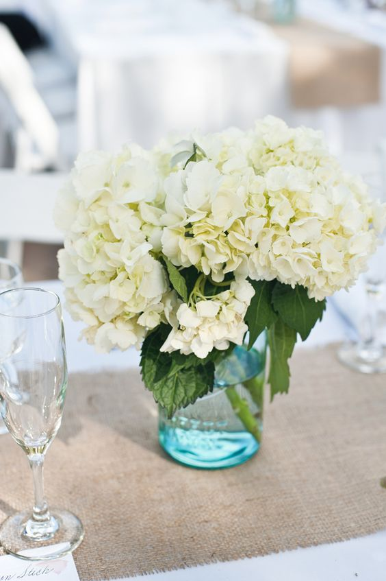 Hydrangea centerpiece in an blue mason jar photo by