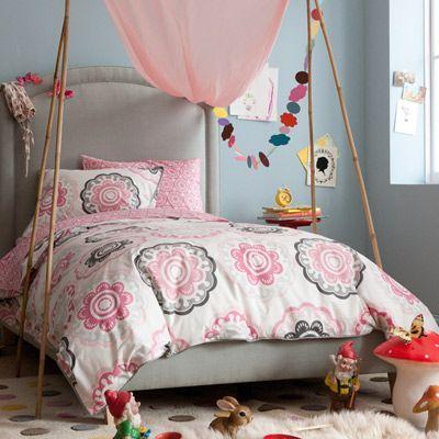 Loving the impromptu little shelter over the bed