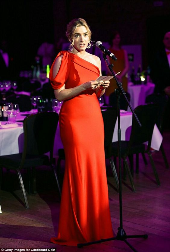 Belle of the ball: The 39-year-old actress showed off her curves in the red, asymmetric number