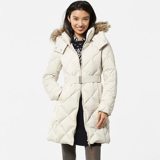 This warm down coat is made with flexible materials and an