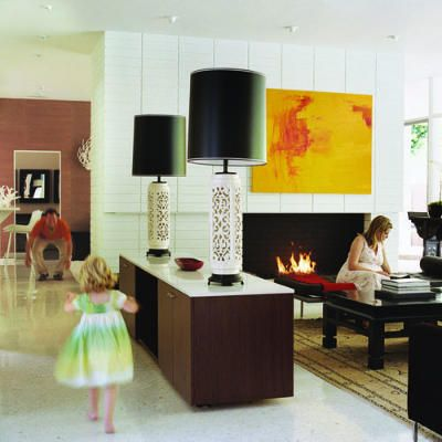 divide a room without using walls - using credenza with towering lamps