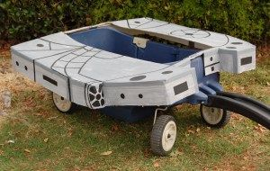 Our DIY Star Wars Millenium Falcon Wagon for Halloween. Completed for only $4: Cardboard (from Costco), Duct Tape and Paint! May the Force Be with You! www.Oopsibaby.net