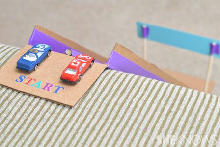 DIY race car track made out of cardboard and duct tape!  So simple but so fun!