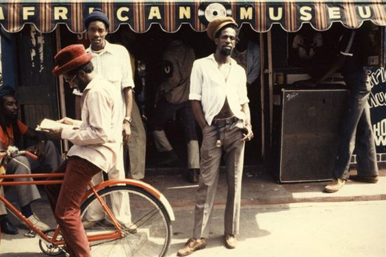 Credit: Beth Lesser/Soul Jazz Records Publishing - Gregory Isaacs in front of his African Museum store on Chancery Lane, Kingston