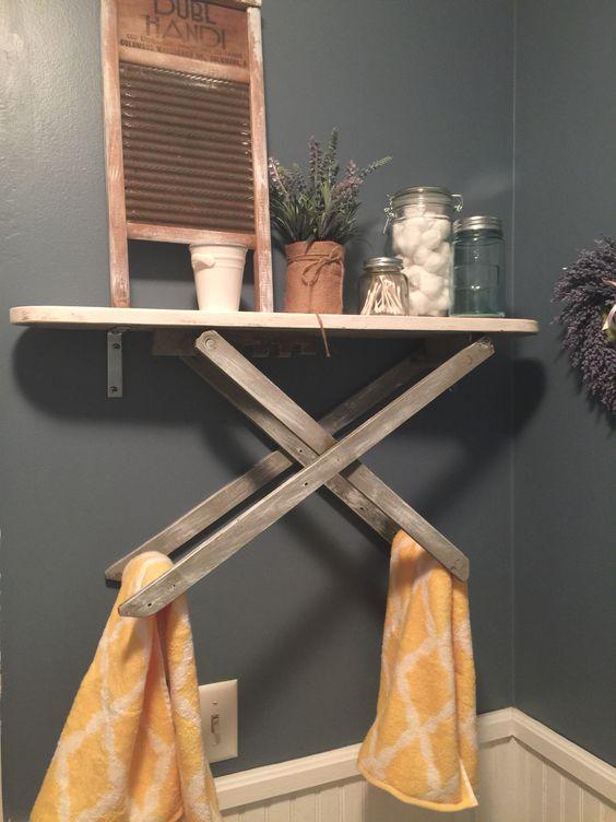 Repurposed vintage ironing board into bathroom. towel rack/ shelf: