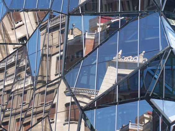 Mirrored images on a sunny morning...this odd building is on Bilbao city center...