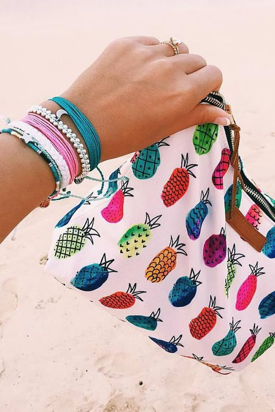 Our Pineapple Clutch + Stack of Pura Vida Bracelets Use the code BRIDGETKARCHER20 to get 20% off: