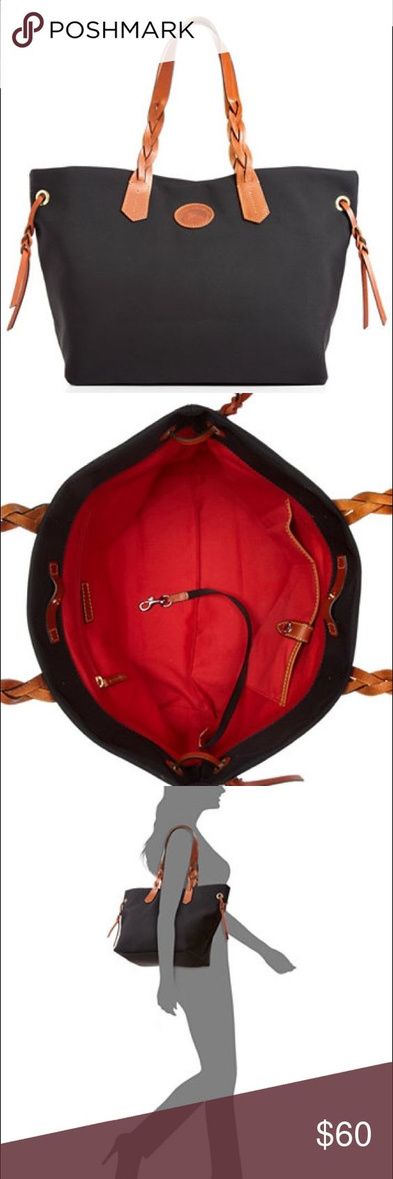 Dooney & Bourke Nylon and leather Shopper Tote Black nylon tote bag with beautiful cognac leather straps. Used only a 3 times for travel! Great bag with beautiful red lining! Almost brand new great condition! Still in stores! Dooney & Bourke Bags Totes
