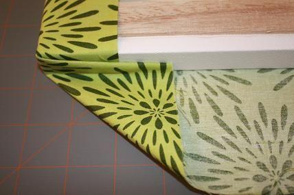Folding fabric around canvas to make wall art.