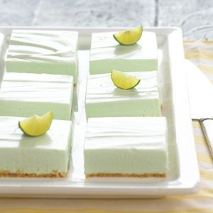 These dazzling bars are a takeoff of the popular pie recipe. This version uses a graham cracker crust and a filling that blends lime-flavored gelatin, cottage cheese, cream cheese, and whipped topping.