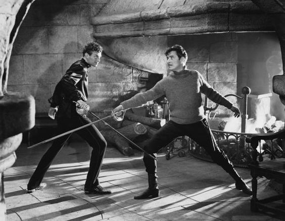 Sword Fight  Caption:	 1937: American actor Douglas Fairbanks Jr and Ronald Colman engaged in furious swordplay in a scene from the swashbuckling adventure, 'Prisoner of Zenda', directed by John Cromwell. (Photo by John Kobal Foundation/Getty Images)  Date created:	 01 Jan 1937: