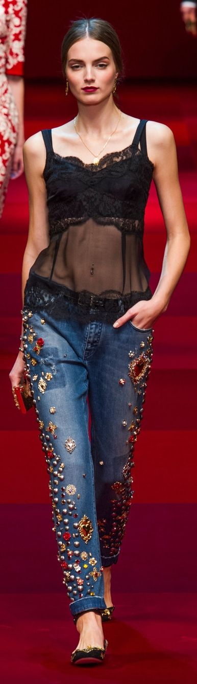 This Fall 2015 Dolce and Gabbana piece perfectly represents the embracement of denim in the sixties and seventies. The embellishment detailing on the jeans reflects seventies, as denim was traded often with hand crafted detailing. Also, women wore bralettes in the seventies which is also shown in this outfit. 3-23-15: