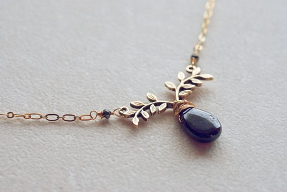 Garnet and branch necklace by mysteryandmanners on Etsy. This has a real vintage feel :)