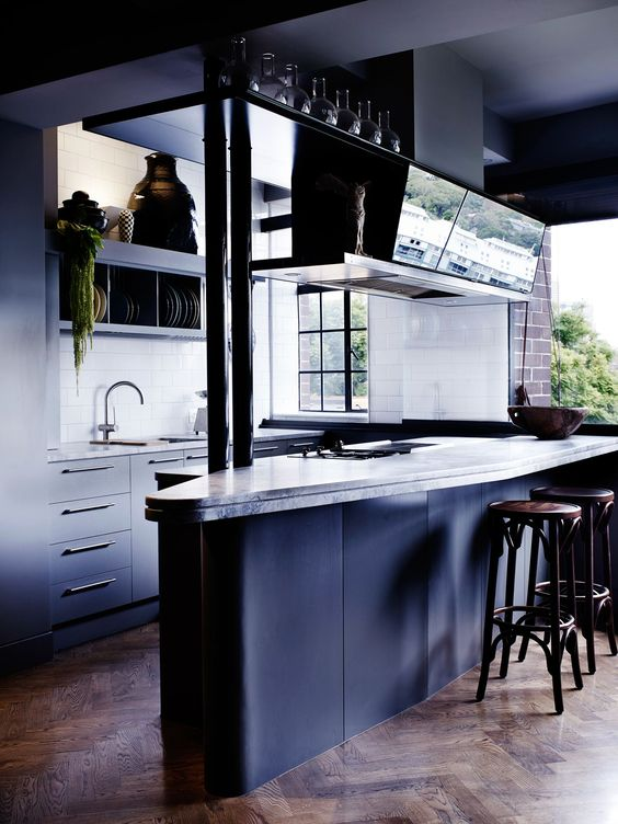 The prow-like form of the kitchen's island bench and the grey colour scheme of this converted inner-Sydney apartment are a nod to the nearby naval base at Garden Island.