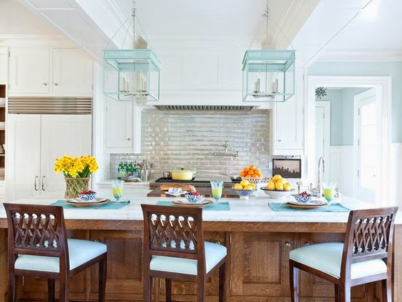 Wood and pale blue color palette in this beach house kitchen.