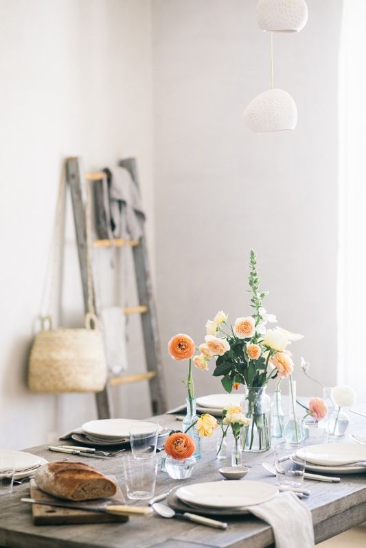 Click to see the full scoop on this fabulous modern farmhouse kitchen! Inspiring kitchen decor and rustic decor elements including this tablescape by Beth Kirby of Local Milk. #kitchenideas #kitchendecor #modernfarmhouse #tablescape #bethkirby #slowliving