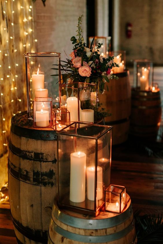 Candles are the dream rustic wedding decoration. Display them in lanterns or glass jars so they can't be knocked over or the flame catch anything. They add so much character and atmosphere to aisles, tables, staircases and more. Visit Hitched for 35 wedding decoration ideas