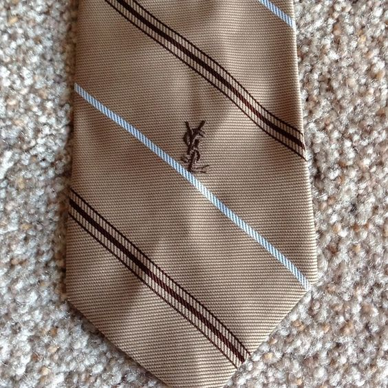 Yves Saint Laurent tie In excellent condition. It is tan color with white and dark brown stripes. I have a maroon color in different listing if interested in a bundle.                                        b Yves Saint Laurent Other