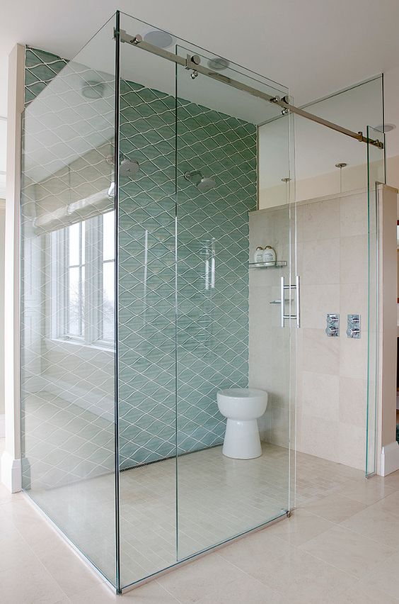 Floor To Ceiling Glass Shower With Diagonal Blue Tile