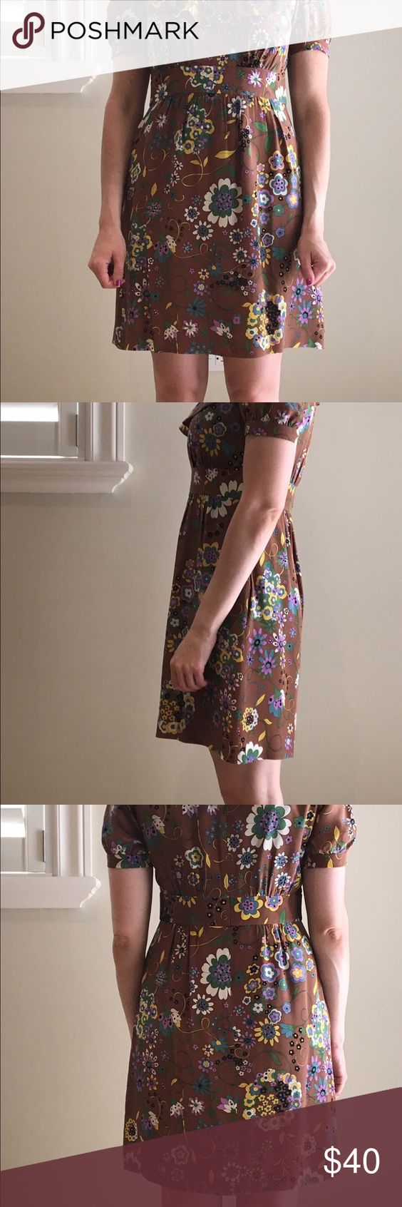"""Tibi Silk Floral Sh Sleeve Silk Dress -Size 6 Welcome to the fall palette!  FUN AND FLIRTY, this silk floral dress is colorful and happy.  A small ruffle around the scoop neck is a feminine touch.  The pockets in the dress and the flowy bottom of the dress make it easy and comfortable to wear.     Great mix of colors. Perfect condition.    Dress it up with pumps or wear with chic flats. Add a sweater or blazer in the fall and wear it """"as is"""" during the warmer months.     This versatile…"""
