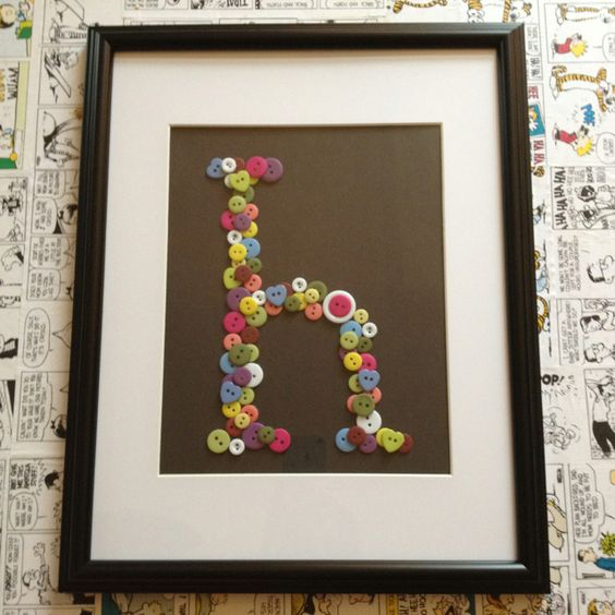 Framed monogram made with buttons