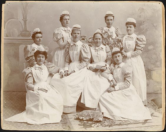 An elegant studio portrait of a graduating class of nurses from the late 1890s.