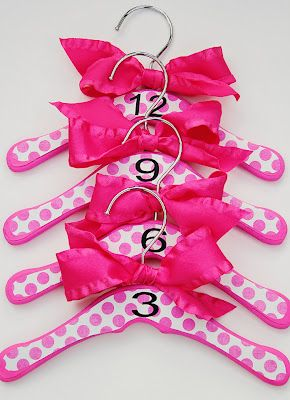 Do-It-Yourself baby closet dividers!  This was a lifesaver when my kiddos were little babies!  So helpful to have their closet sized!  Love the bows to have them stand out in their closet.
