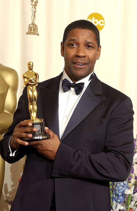 Denzel Washington with an award