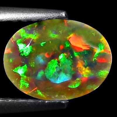 1.07cts Top Volcanic Glow! 360o Patchwork Harlequin Faceted WELO Opal -->Precious opal with color play has numerous tiny silica spheres that are arranged in order in the structure. You see the color play, when the light hits the spheres and is diffracted by them. The broader the light spectrum is, the wider color range you see. --> You can get 1.07cts Top Volcanic Glow! 360o Patchwork Harlequin Faceted WELO Opal for just $90.00 (a 70% savings!) at http://clickmarketclick.blogspot.com