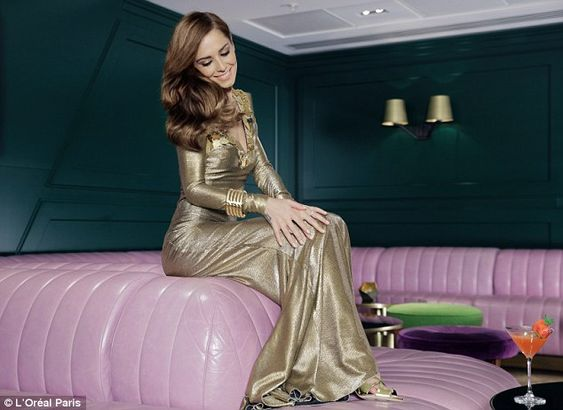 Golden girl: Pop star Cheryl is wowing fans in her latest campaign for beauty brand, L'Ore...: