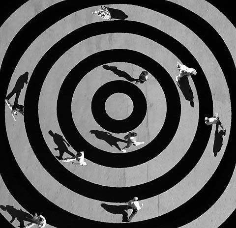 Russian photographer Alexey Bednij's latest project is a series of visual illusions crafted from his portraits of people and animals. To develop these mind-bending compositions, what he calls his 'collages', Bednij will sit and wait until his scene is perfectly placed before snapping the shots and manipulating shadows in these high contrast black-and-whites.
