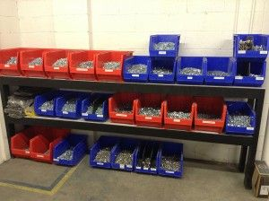 Color coded bins for hardware in a warehouse  #warehouse #bins #inventory #hardware  https://simplastics.com/blog/improve-supply-chain-logistics-with-bins-containers/