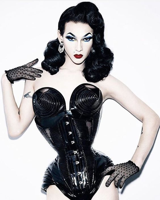 9/16/2016 Violet Chachki - Inspiration taken from silhouette. Unnatural anatomy of the body. Bodice has same medium, but details in the breast bring out the blatant power of femininity in the piece. The arm placement on the hip adds to the ability to play with the sillouete shape.
