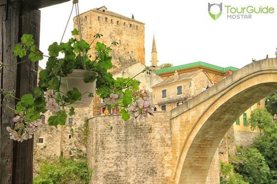 Blooming summer in the picturesque Old Town of Mostar. Visit our website: www.tourguidemostar.com #bloom #tourism #oldtown #mostar #oldbridge #visitmostar #tourguidemostar #explore #travel #bosniaandherzegovina