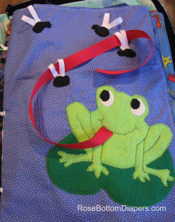 Feed the Frog quiet book page.  Cute way for toddlers to build motor skills.   Busy book ideas at RoseBottomDiapers.com