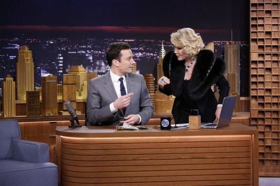 Fashion critic and comedian Joan Rivers gets close to Jimmy Fallon.
