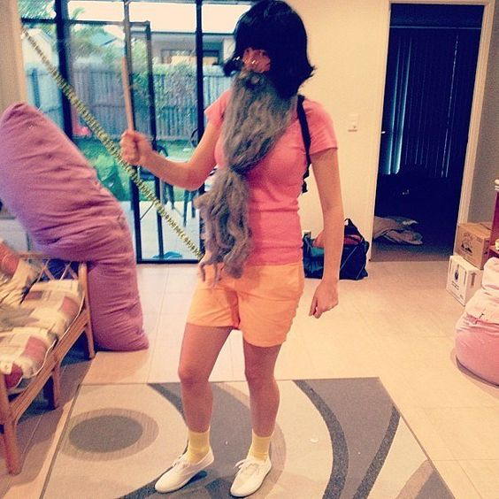 Pin for Later: 70 Mind-Blowing DIY Halloween Costumes For Women Dumbledora the Explorer Combine your love of Harry Potter and children's cartoons by adding a wand and beard to colourful clothing. Pack some spell books in your backpack!