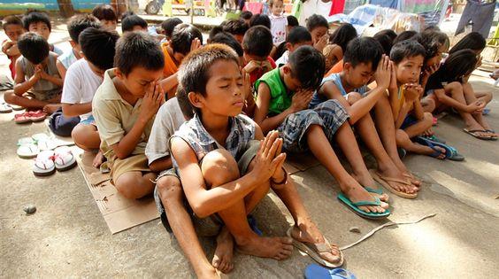 Typhoon Washi survivors in prayer