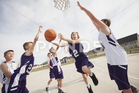 Caucasian Boys Playing Basketball On Court Stock Photo 29615810 Youth Basketball Basketball Basketball Leagues