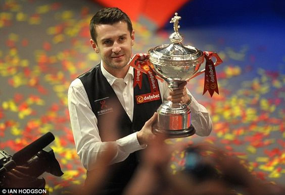 Duck broken: Mark Selby lifts the trophy after winning his first Sonner World Championship title