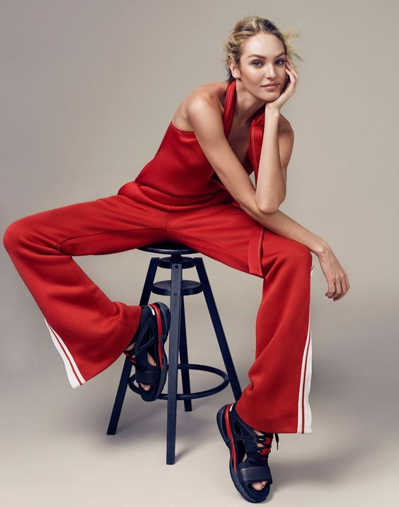 Candice Swanepoel Goes Sporty Glam for ELLE China Editorial (May 2016). Sitting on a stool, Candice models a Chloe top and track pants in red