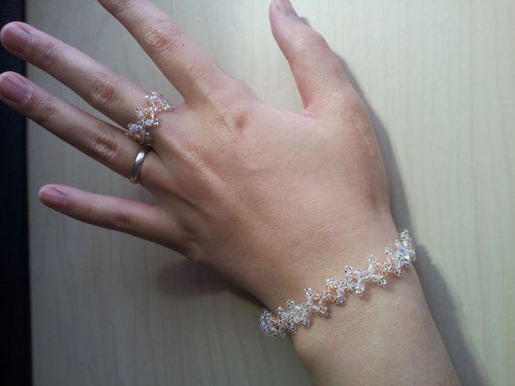 My dear friend in Japan has opened an etsy shop! Please take a look! Her work is lovely!!  Swarovski light  peach and crystal bracelet by NeoUniverseTaro, ¥5000
