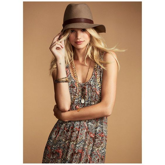 Cute hat / dress combo - love that necklace.