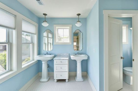 This would be cute for the upstairs bathroom!   double pedestal sinks in blue bathroom