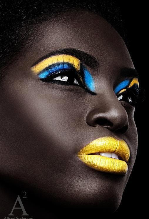 A beautiful Bahamian face with Bahamian flag colors. (Bahamas, Caribbean)