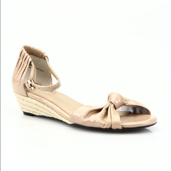 """ASOS """"Sadie"""" Espadrille Wedges  Me Too Taupe Patent Leather """"Sadie"""" Espadrille Wedges. I am strictly selling shoes in my closet that are New, and never worn from now on. These are New, without box. Cute bow top with ankle strap & buckle style. Cushioned insole and leather upper. Size 5-5 1/2. Measurements: Insole 9"""", Width 3"""", Heel 1.5"""". Save with Bundle discounts and free gifts with purchase! Steph ASOS Shoes Sandals"""